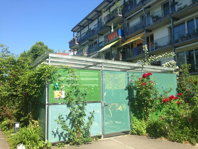 Lockable bike store for two apartment blocks
